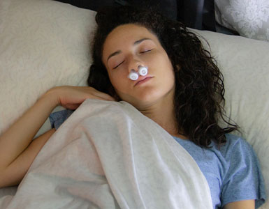 Woman sleeping with Bongo Sleep Apnea Therapy Device